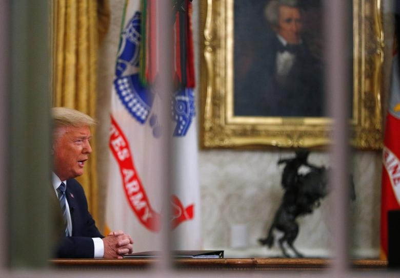 President Donald Trump addresses the nation during a live television broadcast regarding the coronavirus pandemic, from inside the Oval Office at the White House in Washington, March 11, 2020
